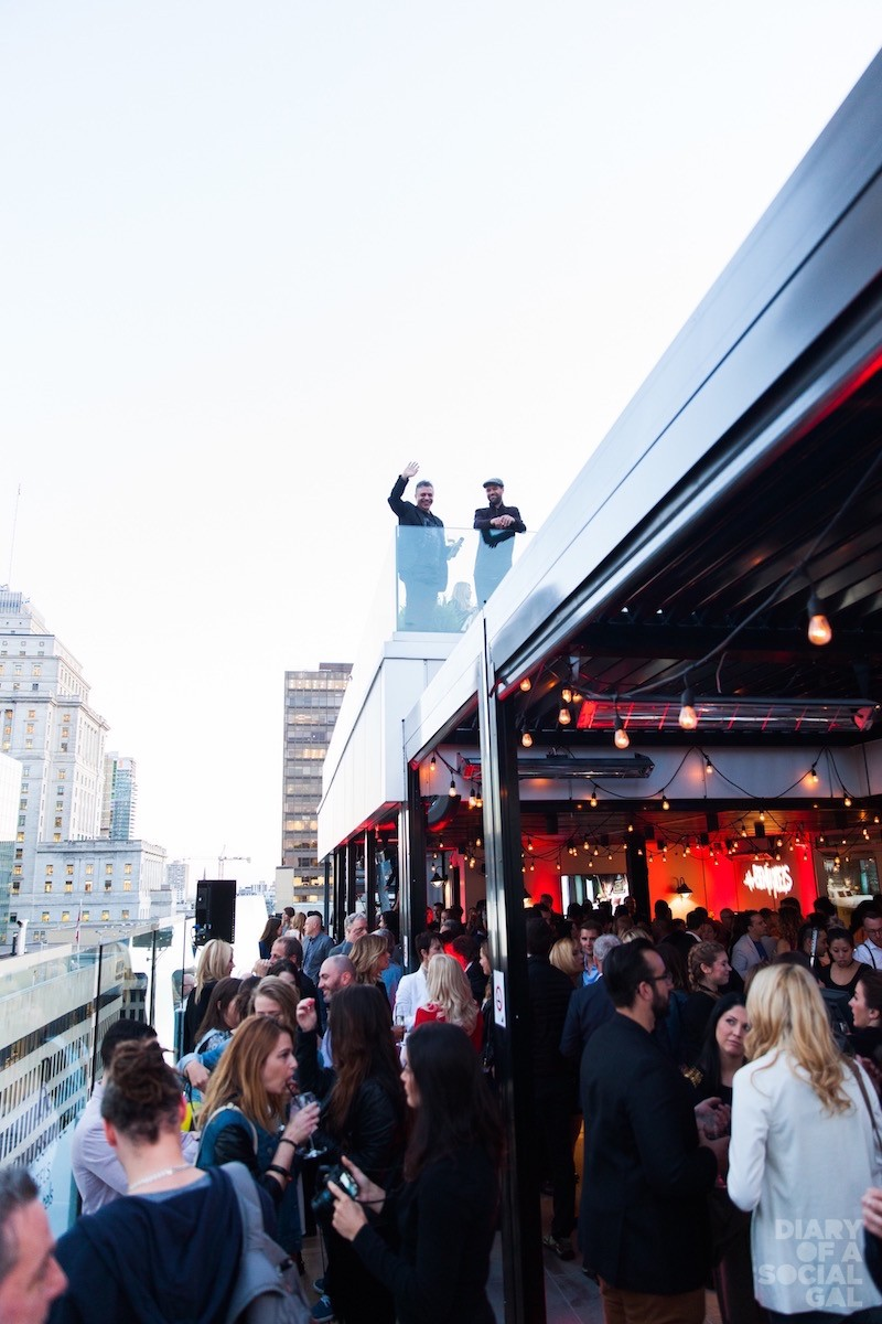 ROOFTOP RENAISSANCE: Glam guests hit the rooftop terrace for mega launch fun.