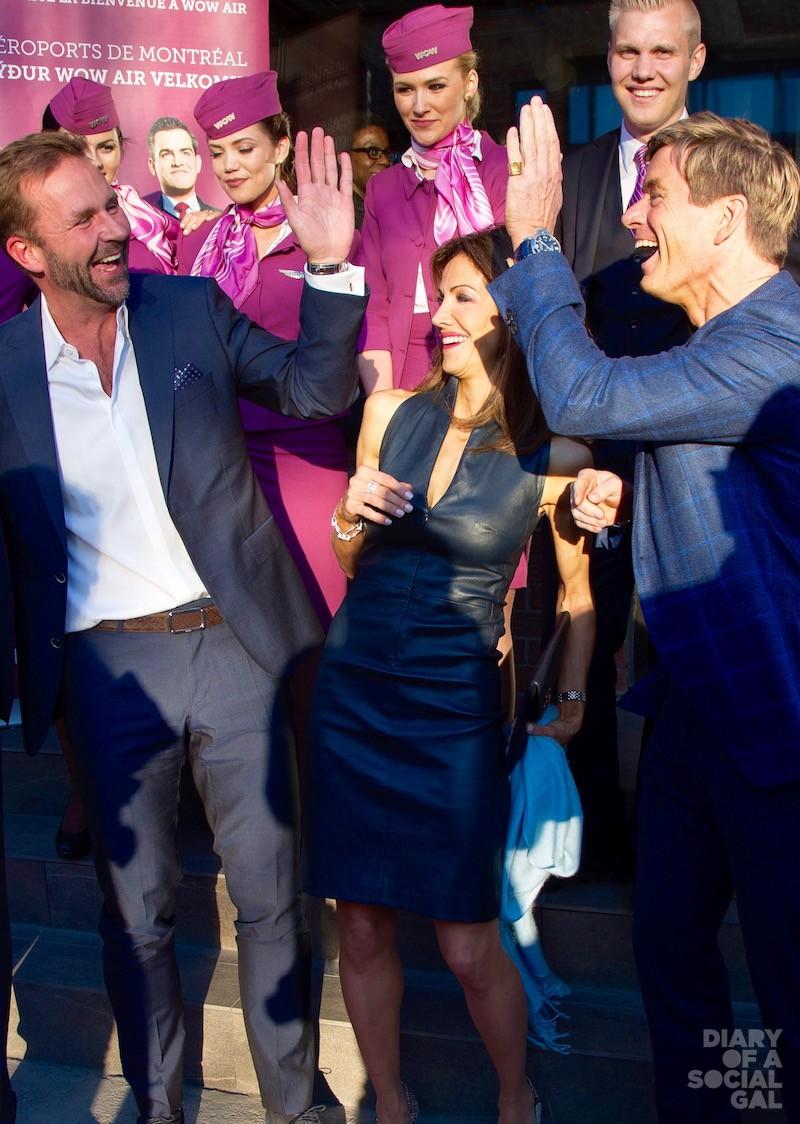 TO WOW! Wow Air founder / CEO SKÚLI MOGENSEN high fives pals NANNETTE DE GASPÉ BEAUBIEN and husband PHILIPPE DE GASPÉ BEAUBIEN at his Montreal launch.