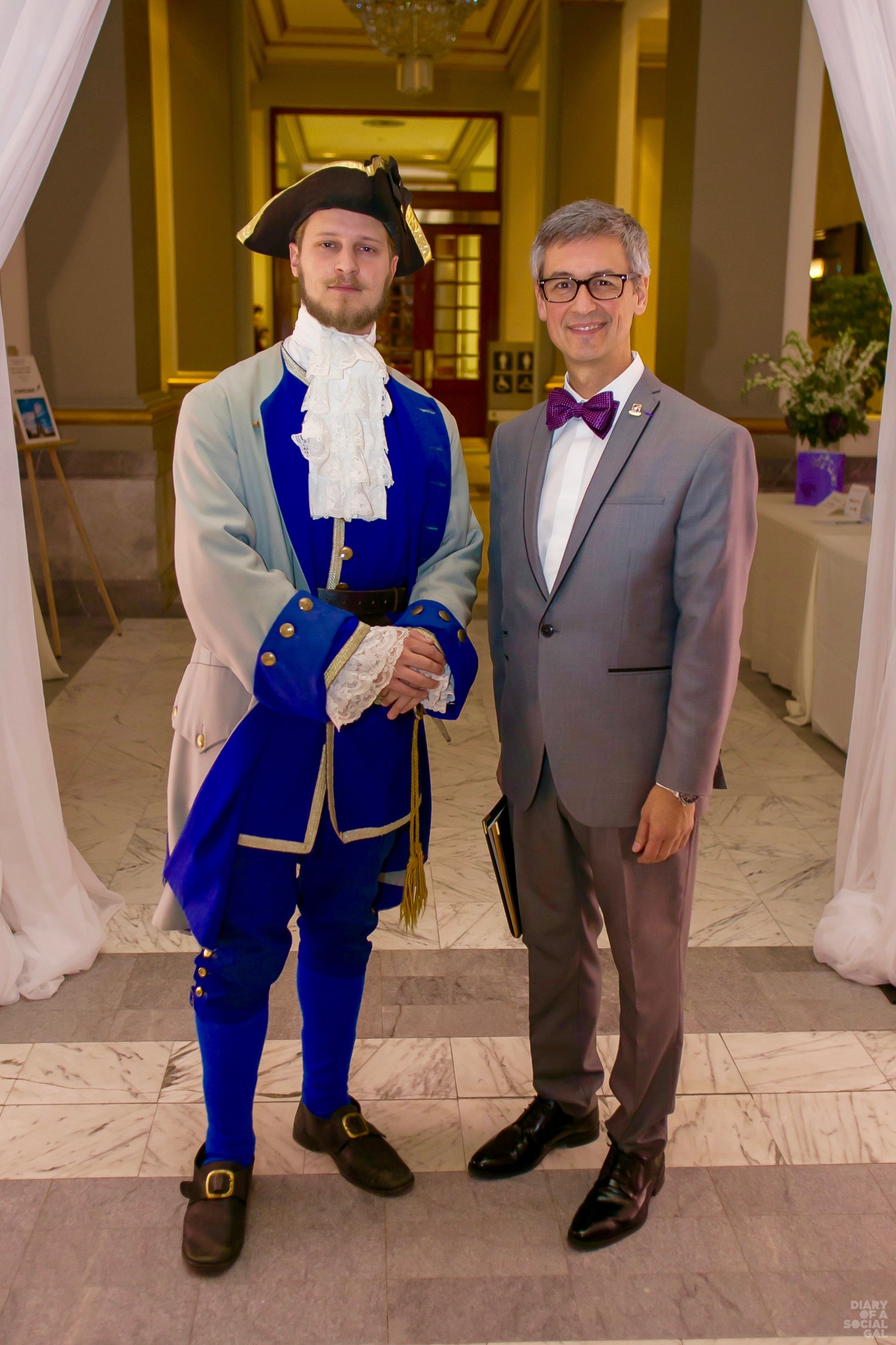 HERITAGE CHIC: A sartorially expert host of years past poses with Château secret weapon, executive director and curator ANDRÉ DELISLE.