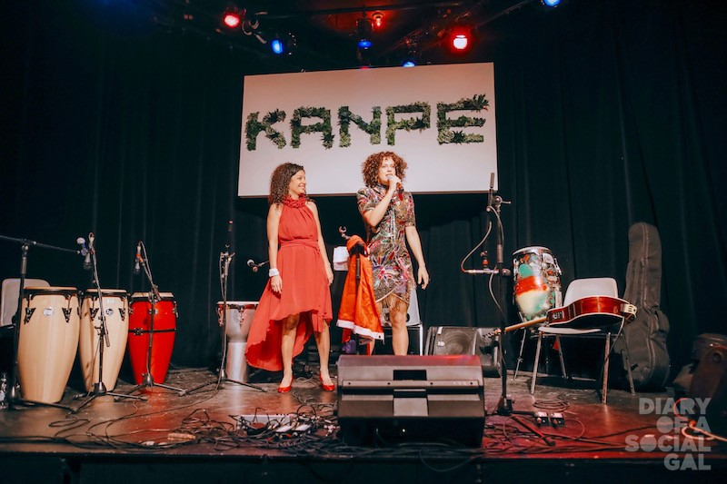 AT THE MIKE: KANPE Foundation co-founders, Quebec minister DOMINIQUE ANGLADE and  Arcade Fire's RÉGINE CHASSAGNE.