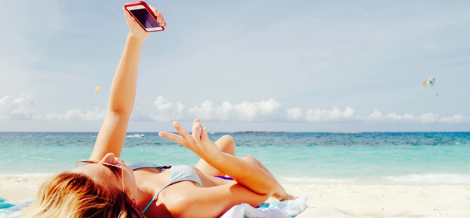Girl In Bikinin Taking Selfie On The Beach (2)