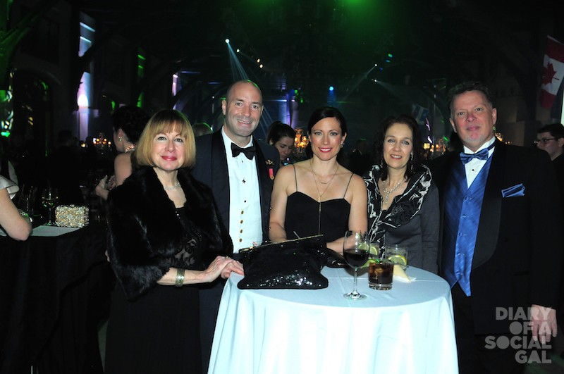 TABLESIDE: Guests ERAMELINDA BOUQUER, COL. DARCY MOLSTAD, wife JODY FOSTER, LAURIE BENNETT, and love DAVE SUPLEVE
