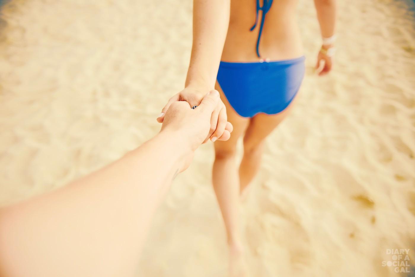 Lovers Holding Hands On Beach With Bikini (1)