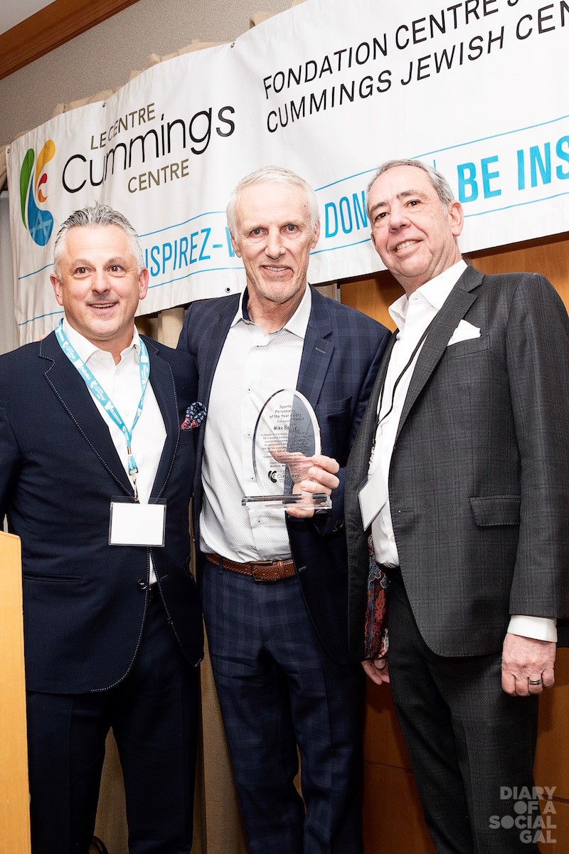 CHAIRWICH: Event co-chairs BRAM NAIMER (left) and MIKE WAGEN (right) present Sports Personality Of The Year MIKE BOSSY, with his award.