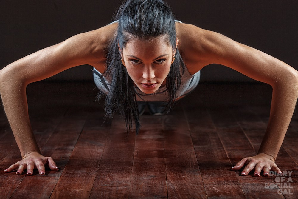 beautiful athletic woman pushed from the floor