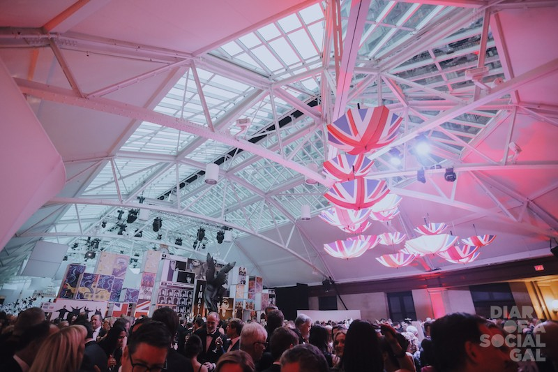 COCKTAIL KICK-OFF: Against the backdrop of a Mondrian-inspired dividing wall, and under a cacophony of suspended Jack umbrellas,guests mix and mingle.