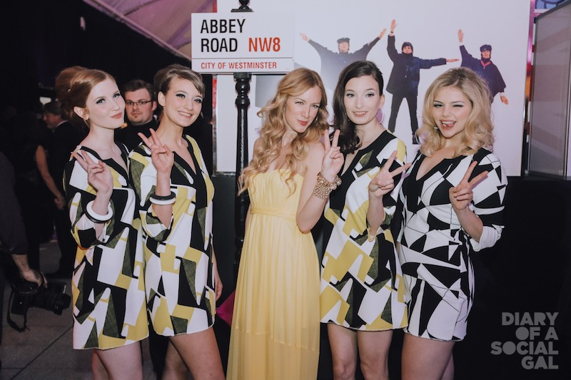 PEACE OUT PRINCESSES: NADINE LAJOIE poses in front of Abbey Road with volunteer hostesses in minis sponsored by Le Chateau with dos by La Coupe.