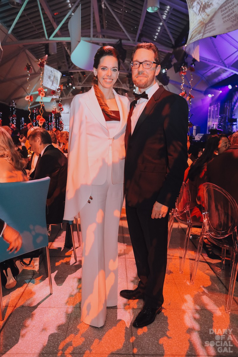 HOLLYWOOD WORTHY! NATHALIE FORCIER, white hot in ELIE SAAB and husband, BMO Capital Markets managing director GREGOIRE BAILLARGEON, in BURBERRY.