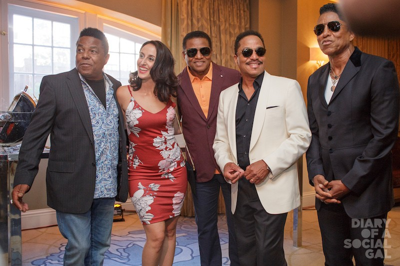 CASELLA JACKSON FEVER: Global Montreal's LAURA CASELLA, with legendary Jackson brothers TITO JACKSON, JACKIE JACKSON, MARLON JACKSON, JERMAINE JACKSON.
