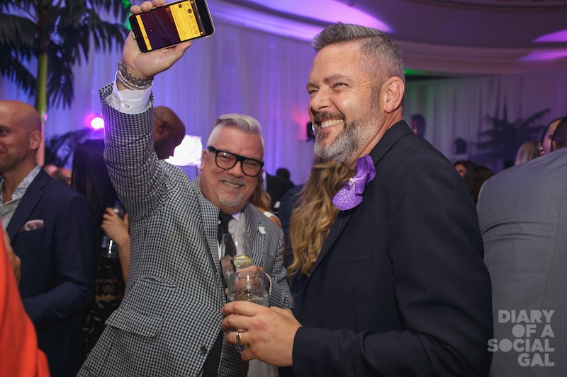 MODERN PEEPS! Holt Renfrew Montreal divisional VP NORMAND CIARLO and DAVID LAPIERRE hit the dance floor.