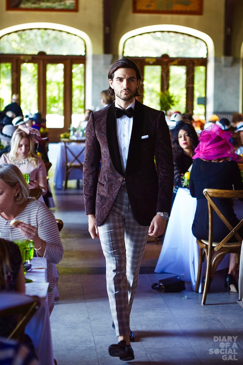 "CHALET CATWALKING:  A well-suited model makes his way down the ""catwalk"" in FINEZZA AU NOM DE LHOMME."